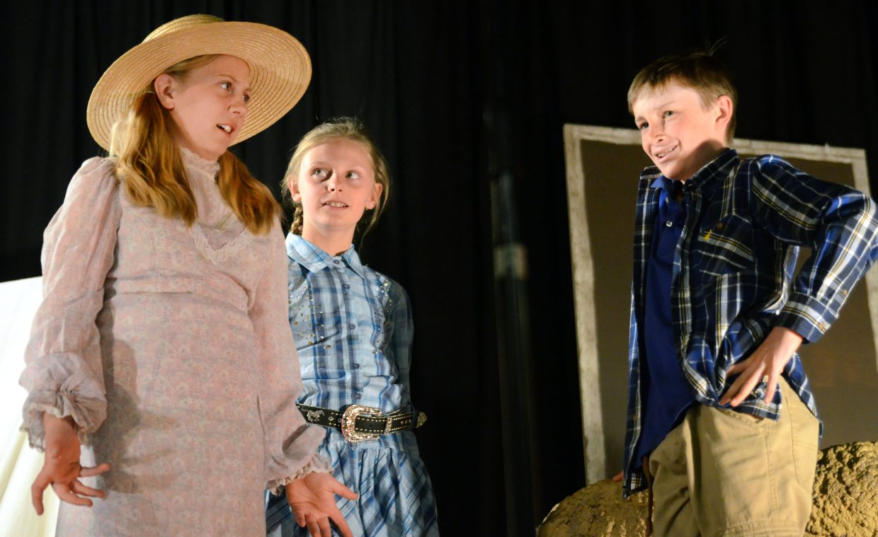 """Bailey Iacovetto, from left, Bethany Leader and Bowden Tumminello rehearse their roles in Heritage Christian School's latest play, """"Jonah's Druthers,"""" which they will perform at 6:30 p.m. Wednesday."""