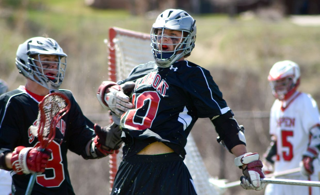 Ben Wharton, right, celebrates a first-half goal in the Sailors' 16-13 loss to Aspen on Saturday afternoon.