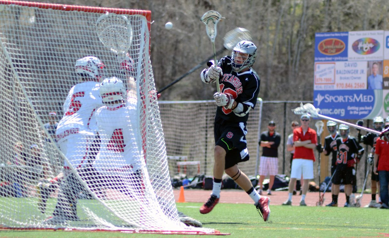 Ben Wharton scores one of his three goals in the second half past Aspen's Jordan Cattrell. Steamboat mounted a second-half comeback that fell short, 16-13, on Saturday.