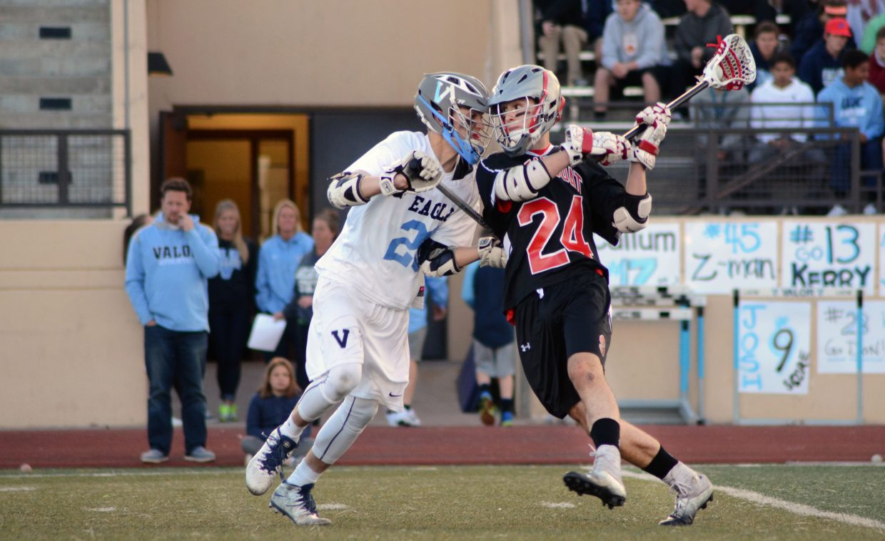 Steamboat's Drew Williamson tries to get a shot past a Valor Christian player in the first half of the Sailors' 14-8 quarterfinals win Friday night.