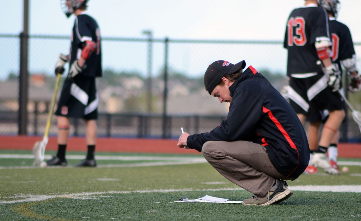 First-year Steamboat boys lacrosse coach Jay Lattimore gives some last-minute inspection to the game plan prior to his team's 14-8 quarterfinals win against Valor Christian on Friday night.