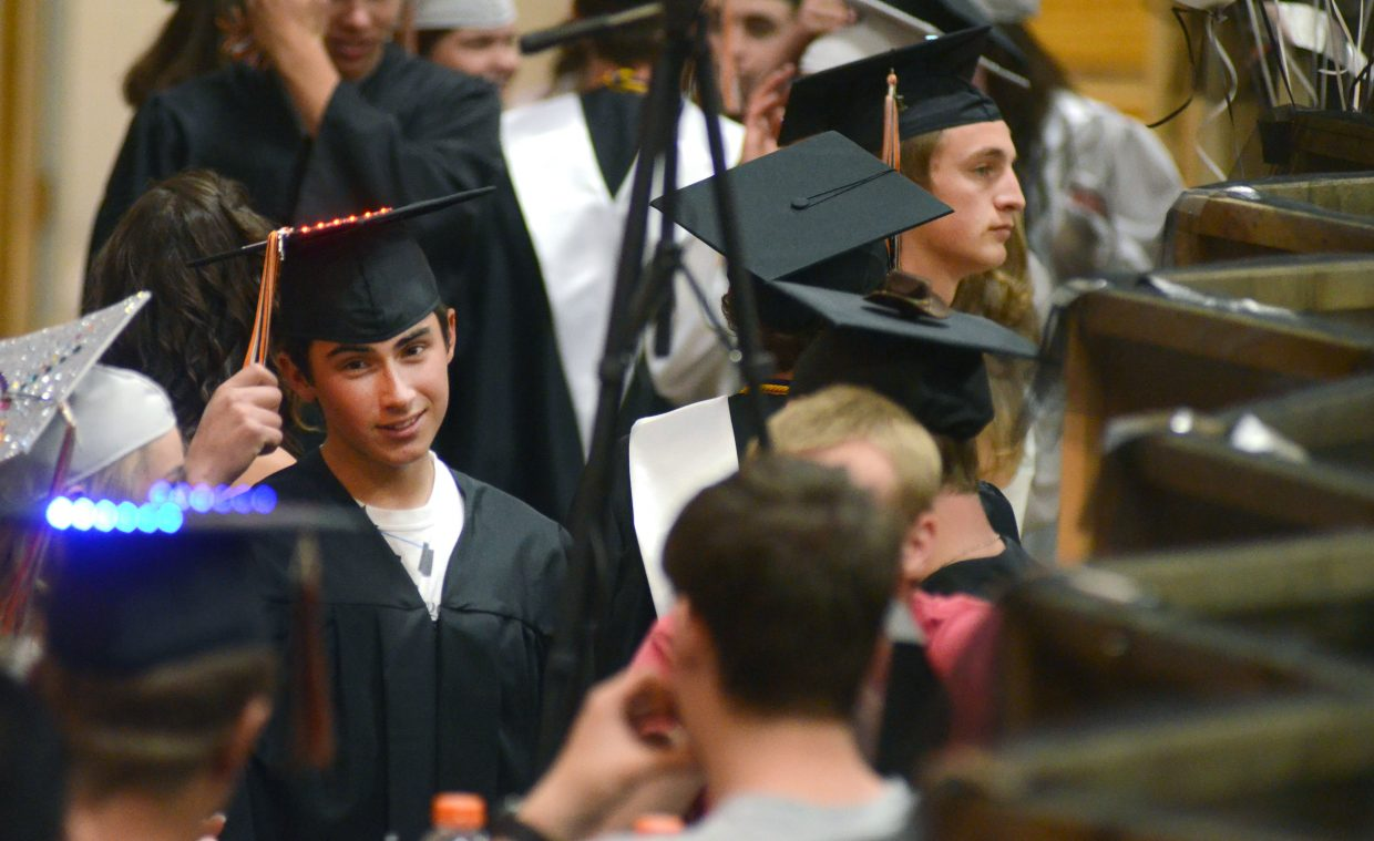 Hayden seniors mingle backstage before the high school's 2014 graduation commencement ceremony Sunday at the campus's gymnasium. Twenty-eight students were awarded diplomas.