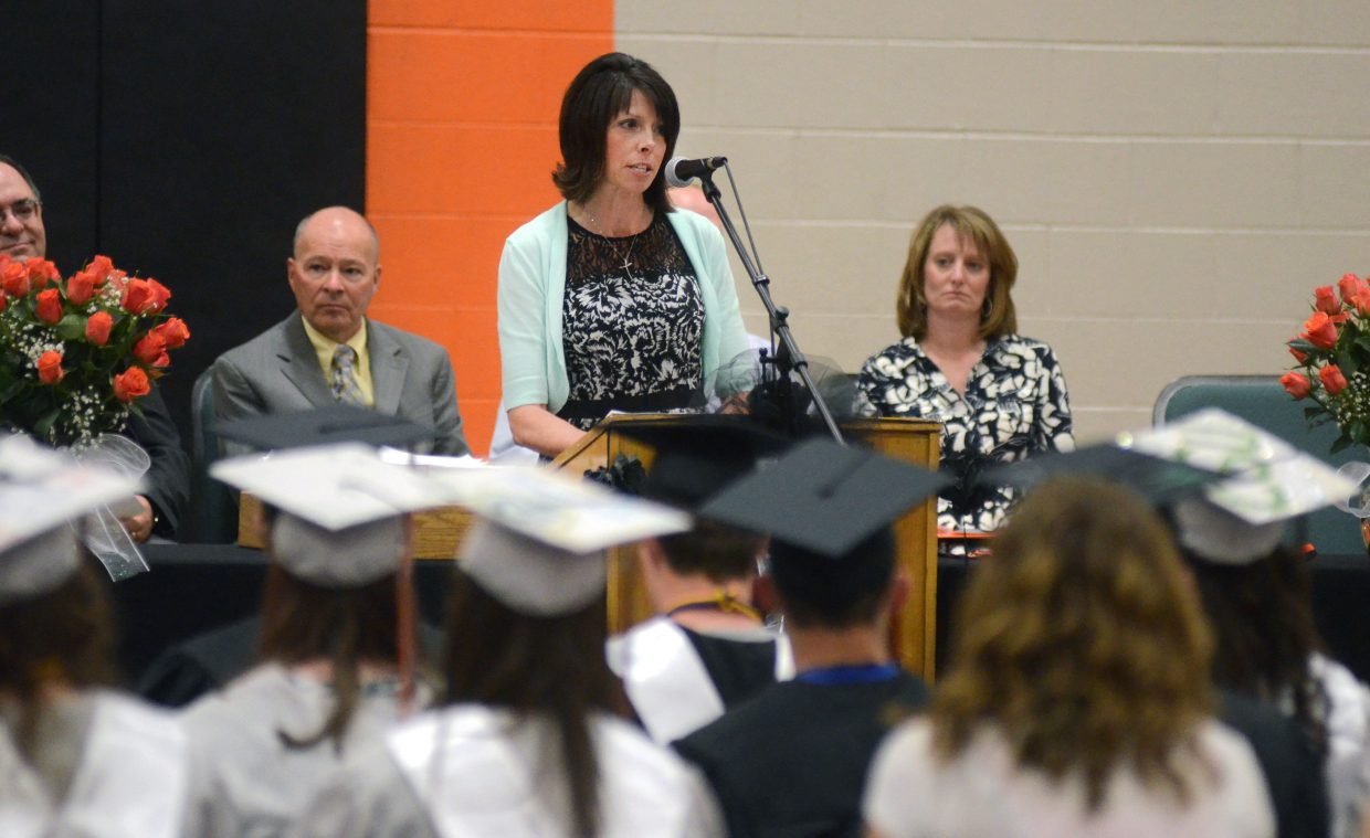 Hayden High School Principal Gina Zabel delivers her introduction speech at the 2014 graduation commencement ceremony Sunday.