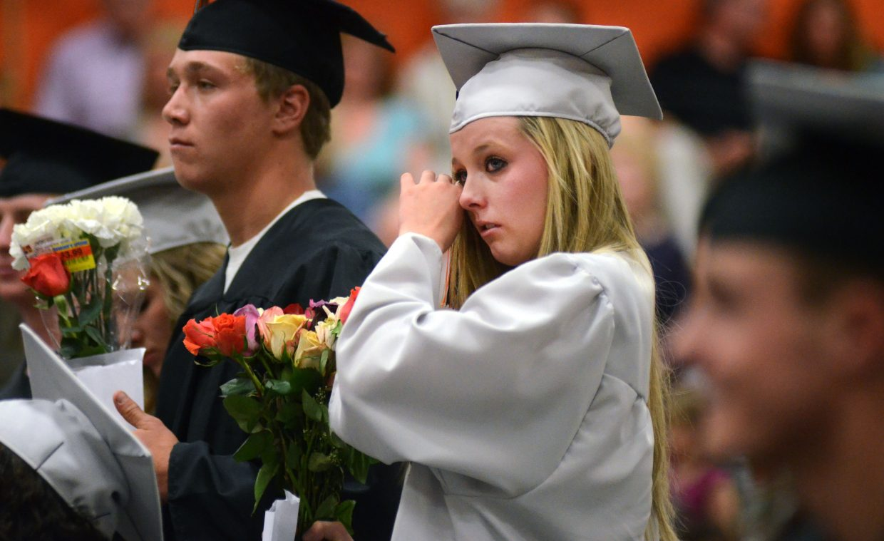 Hayden graduate Miranda Watts wipes away tears after receiving her diploma at Sunday's graduation commencement ceremony.