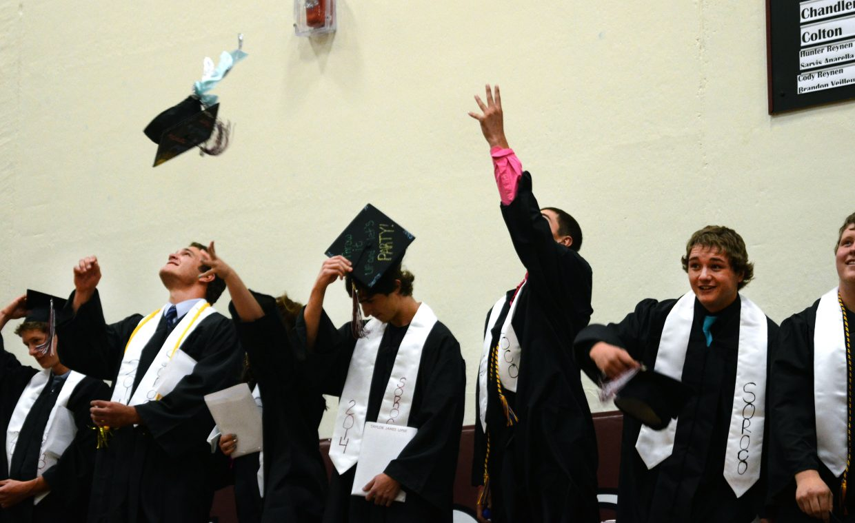 Soroco High School's Class of 2014 toss their caps into the air after receiving their high school diplomas at Saturday's commencement ceremony.