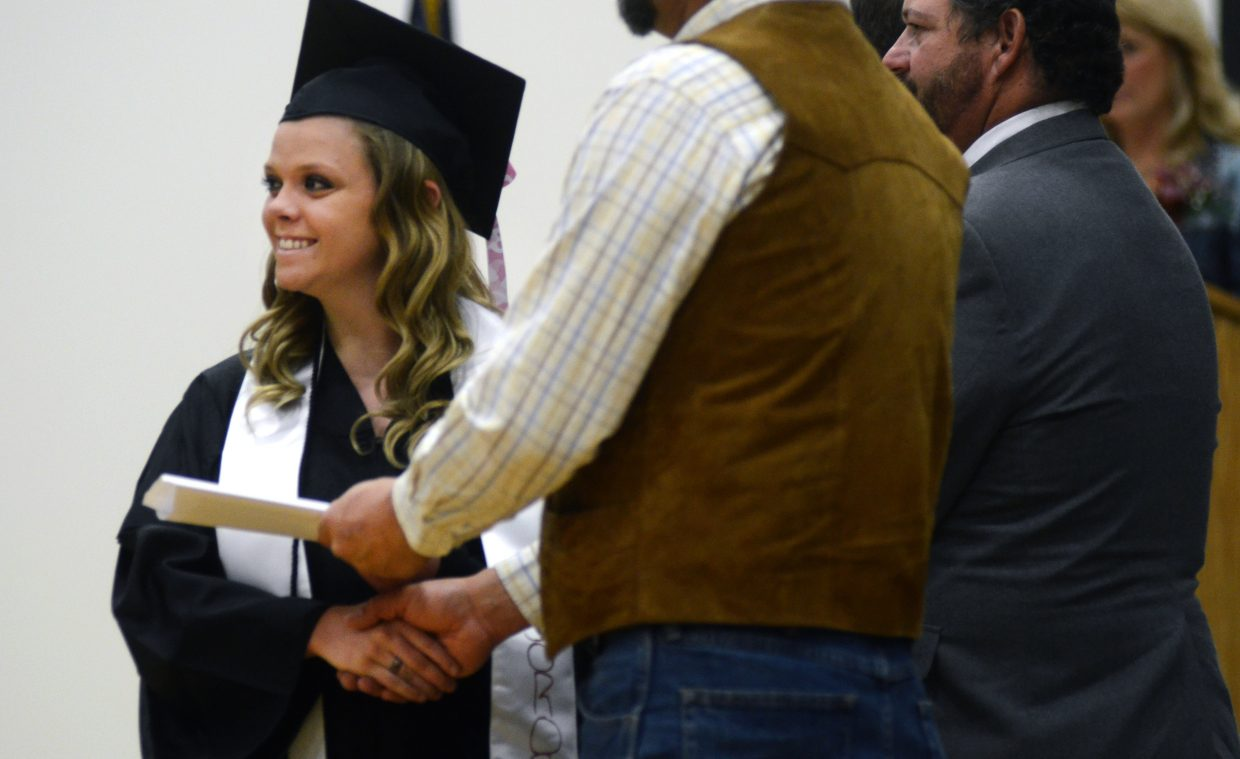Colorado Northwestern Community College-bound graduate Elisa Burdette poses for a quick photo after receiving her high school diploma at Soroco's 2014 commencement ceremony Saturday.