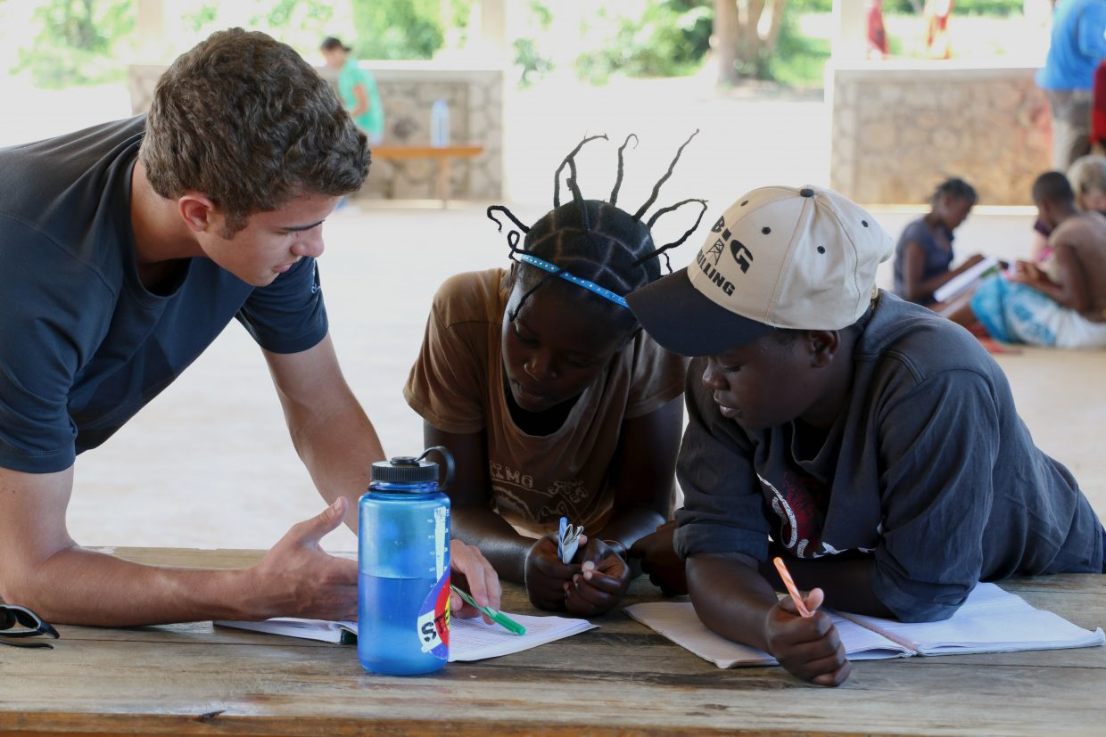 The Lowell Whiteman School senior Dylan Parsons, left, works with a student on the school's senior Global Immersion Studies trip to Tanzania from April 7 to May 2.