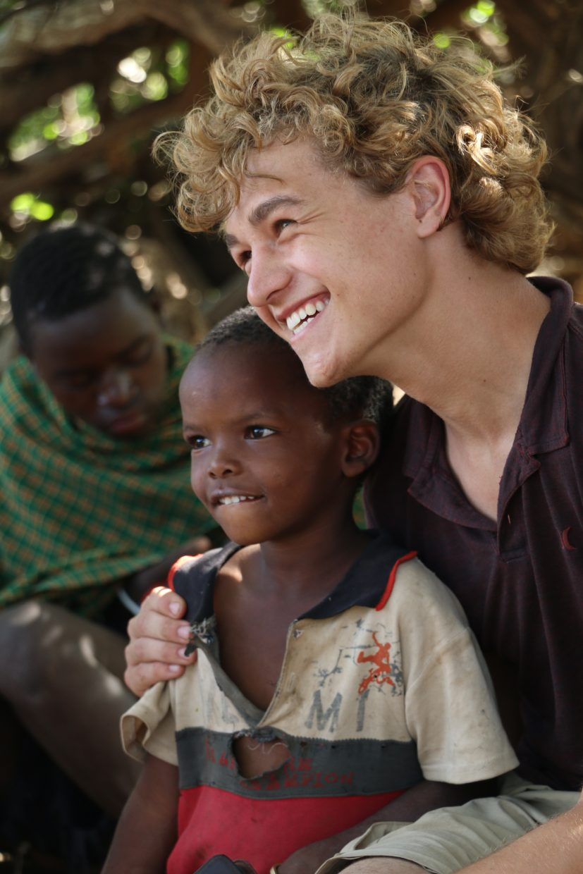 The Lowell Whiteman School senior Sean Timmons poses for a photograph with a Tanzanian student during his Global Immersion Studies trip from April 7 to May 2.