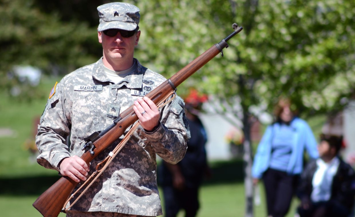 Bret Martin, of the U.S. Army, paces before the start of the Memorial Day ceremony at the Steamboat Springs Cemetery on Monday.