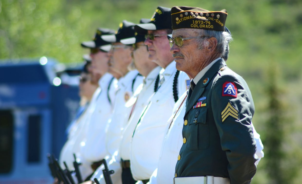 Members of the gun salute line up and wait for Monday's Memorial Day celebration to commence at the Steamboat Springs Cemetery.
