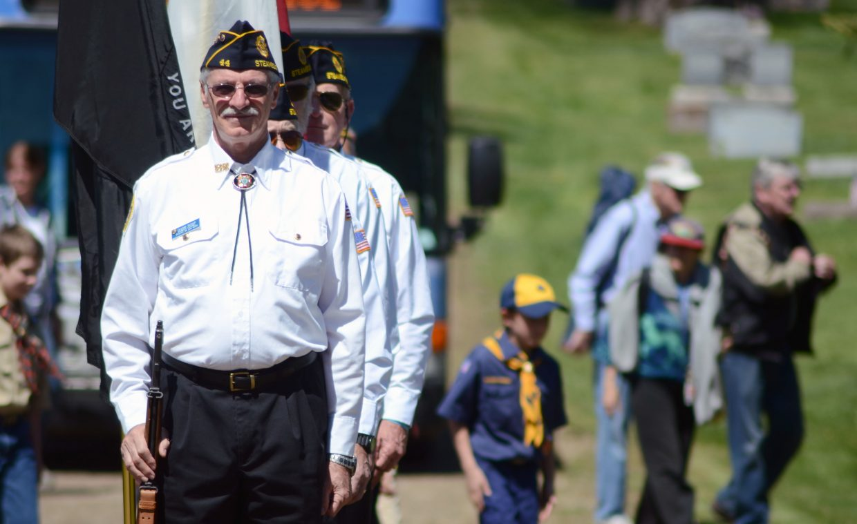Cesare Rosati leads the flag bearers into the Memorial Day celebration Monday at the Steamboat Springs Cemetery.