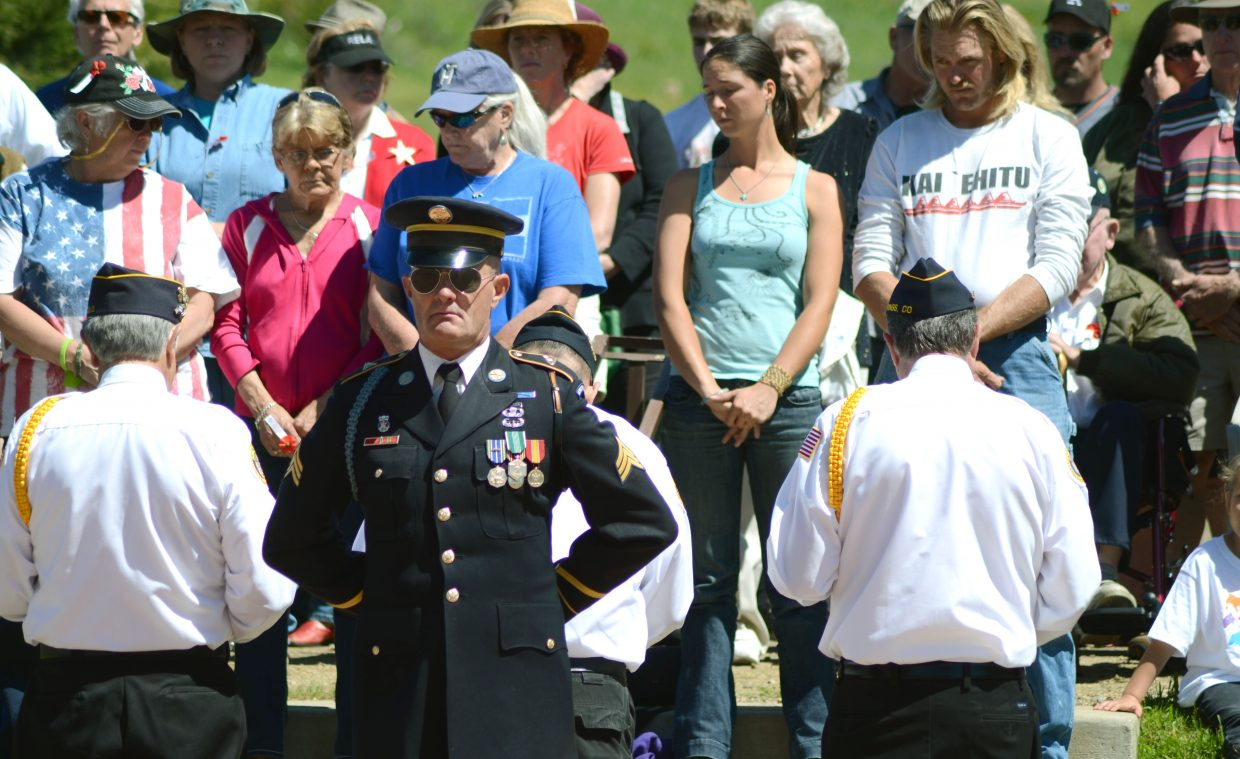 Naval Commander Rick Reinhard leads the Memorial Day ceremony into prayer during Monday's event at the Steamboat Springs Cemetery.