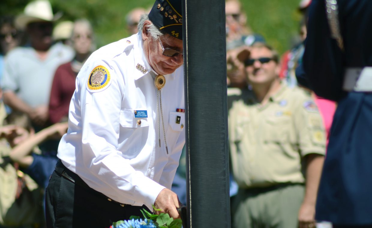 Jim Stanko lowers the flag to half mast at the Steamboat Springs Cemetery during Monday's Memorial Day ceremony.