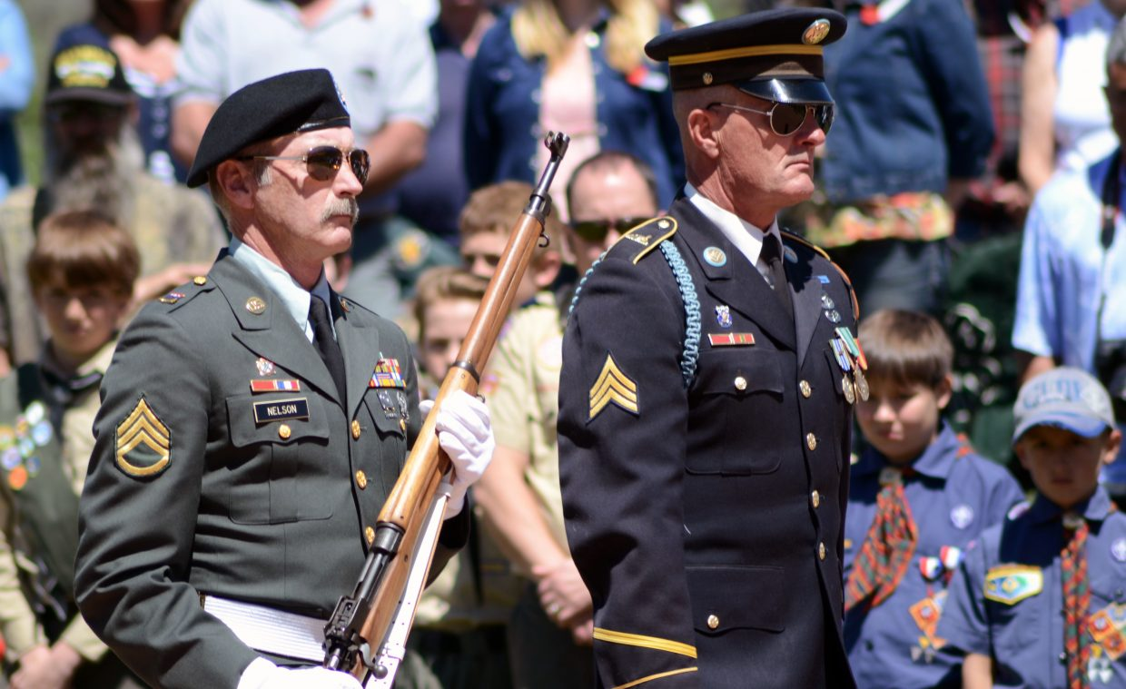 Robert Nelson, left, and Rick Reinhard march during Monday's Memorial Day ceremony at the Steamboat Springs Cemetery.