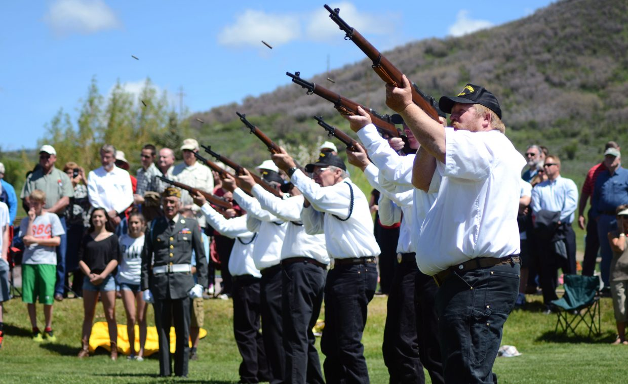Members of the gun salute fire their rifles near the end of Monday's Memorial Day ceremony at the Steamboat Springs Cemetery.