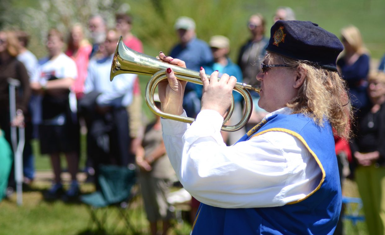 """Valerie Bussey performs """"Taps"""" to close out the 2014 Memorial Day ceremony at the Steamboat Springs Cemetery Monday."""