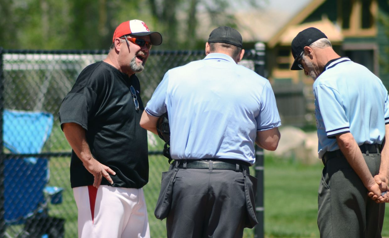 Steamboat American Legion coach Rusty McRight argues a home run call with umpires in Game 1 of the team's 12-3 win against Coal Ridge on Monday.