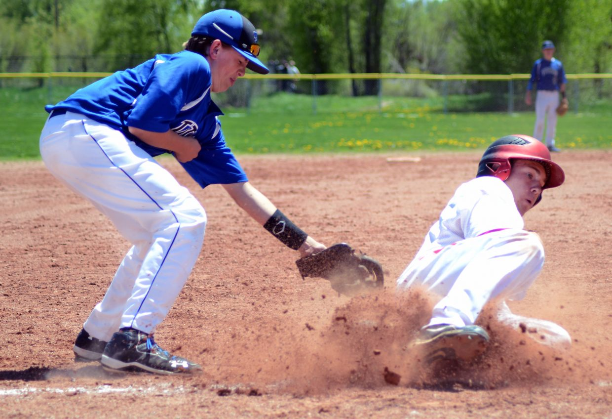 Steamboat's Billy Clark safely steals third in Game 1 of the team's doubleheader victories against Coal Ridge on Monday.