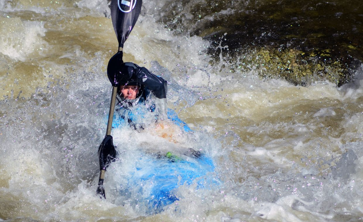 Professional kayaker Martina Wegman, of the Netherlands, dips through a rough stretch in the Paddle Life Fish Creek Race on Friday night to kick off the Yampa River Festival. Wegman was the top women's finisher, crossing in 2 minutes, 50.81 seconds.
