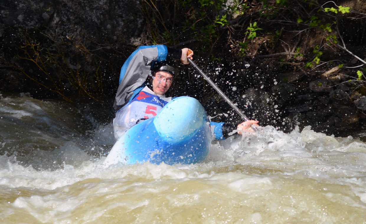 Tad Dennis gets near the bank on a turn in the Paddle Life Fish Creek Race on Friday night.