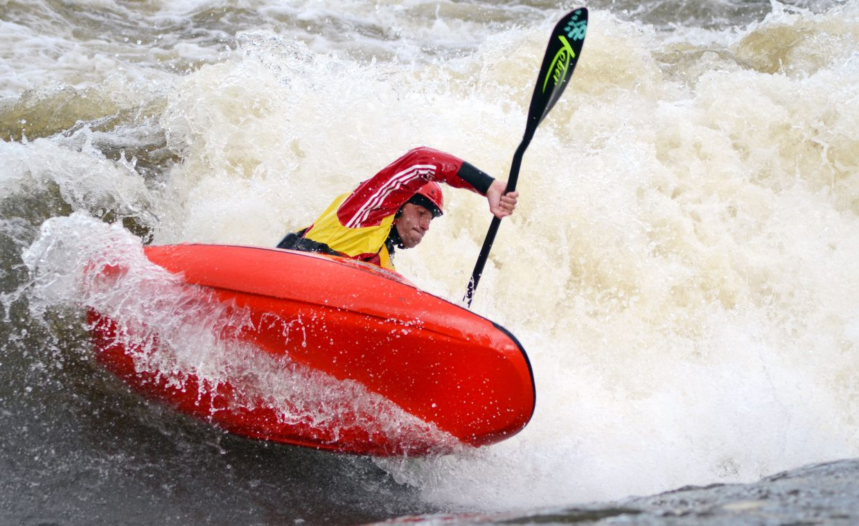 France's Mathieu Dumoulin takes a sharp turn during a trick at Charlie's Hole for the Yampa River Festival's freestyle kayak competition Saturday night.