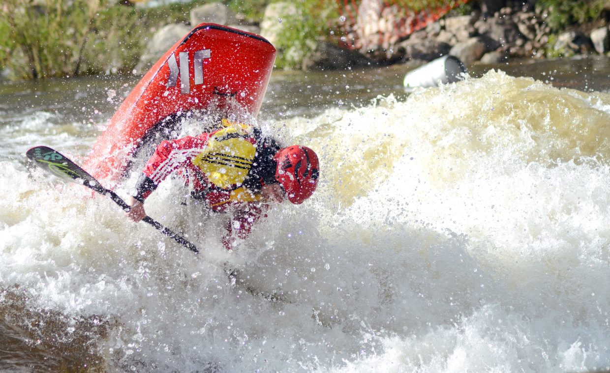France's Mathieu Dumoulin completes a front flip during Saturday's freestyle kayak competition at the Yampa River Festival.