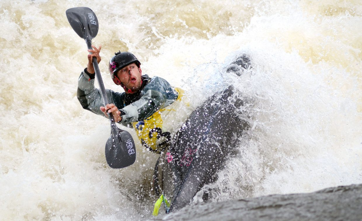 Dave Fusillli comes up from the Yampa River waters during a trick at Charlie's Hole on Saturday during the Yampa River Festival.