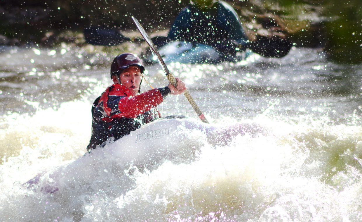 Steamboat's Sarah Piano rides the crest of Charlie's Hole's wave at the 2014 Yampa River Festival's freestyle kayak competition.