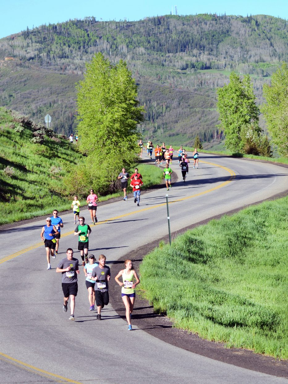 A pack of 10K racers make the turn on Amethyst Drive near Steamboat Springs Middle School on Sunday during the Steamboat Marathon festivities.