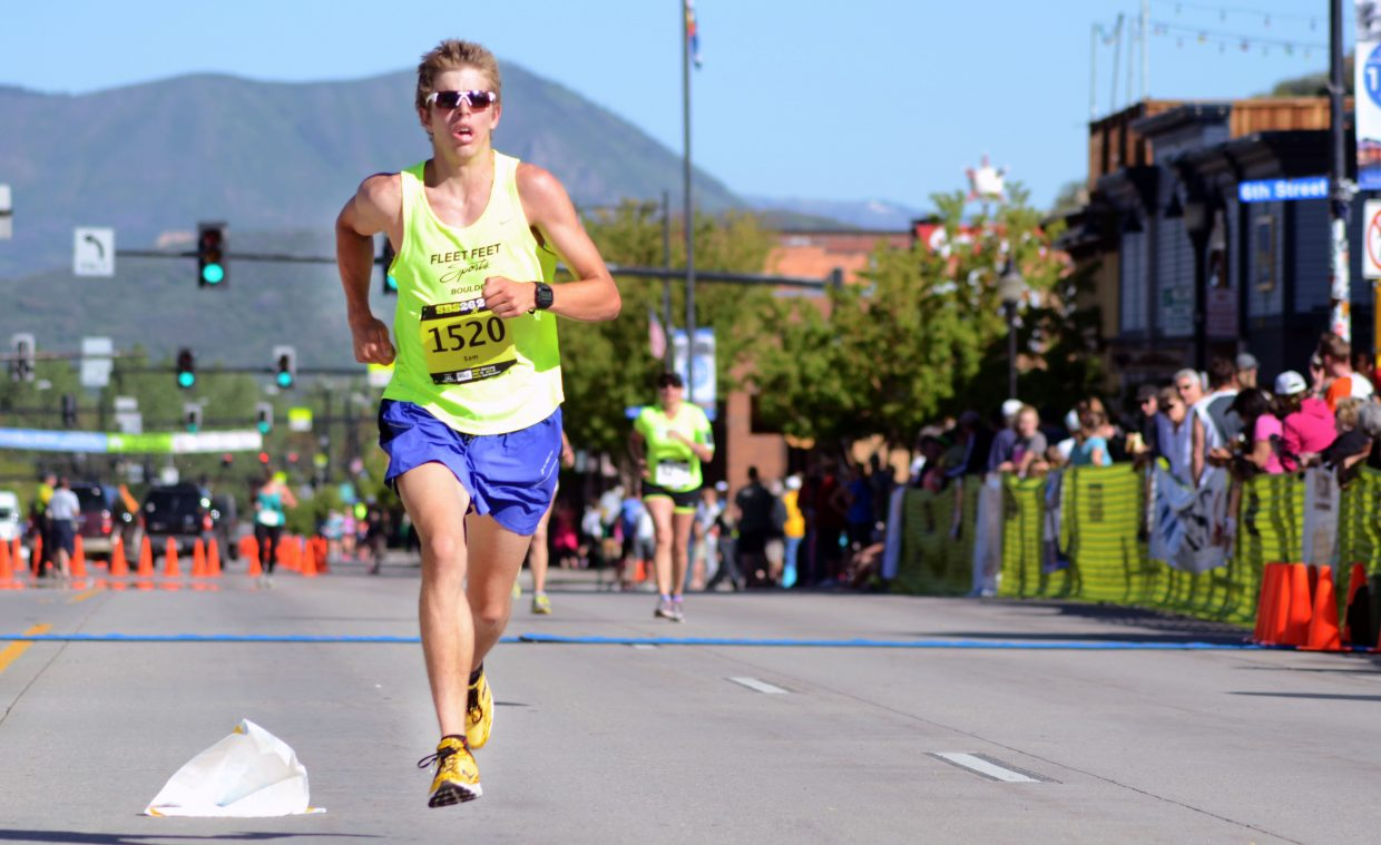 Eighteen-year-old Boulder High School graduate Sam Long coasts to victory in the men's half-marathon Sunday.