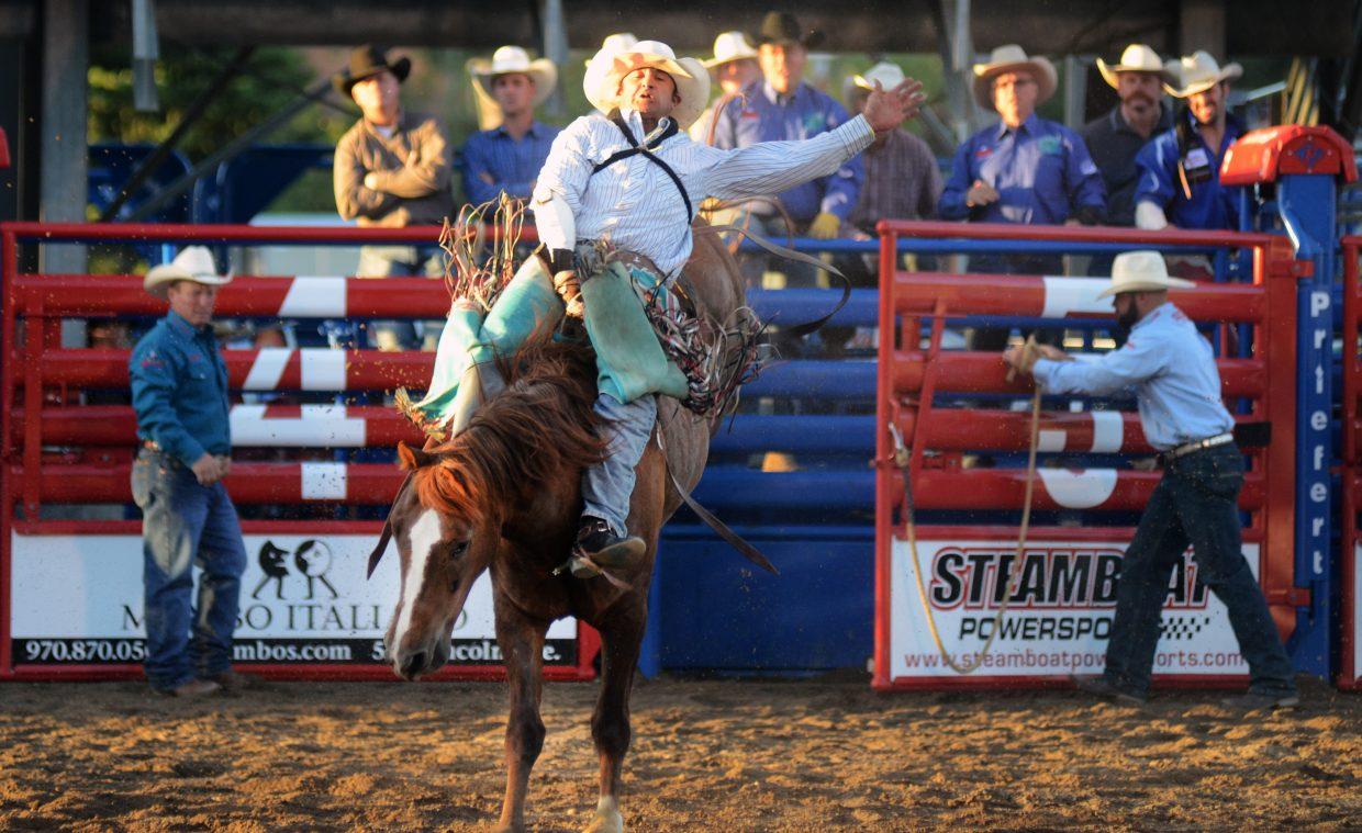 Hartsel, Colorado's Micky Downare holds on tightly to his bronco during Saturday's bareback riding competition at the Steamboat Springs Pro Rodeo. Downare would go on to win the weekend's event.