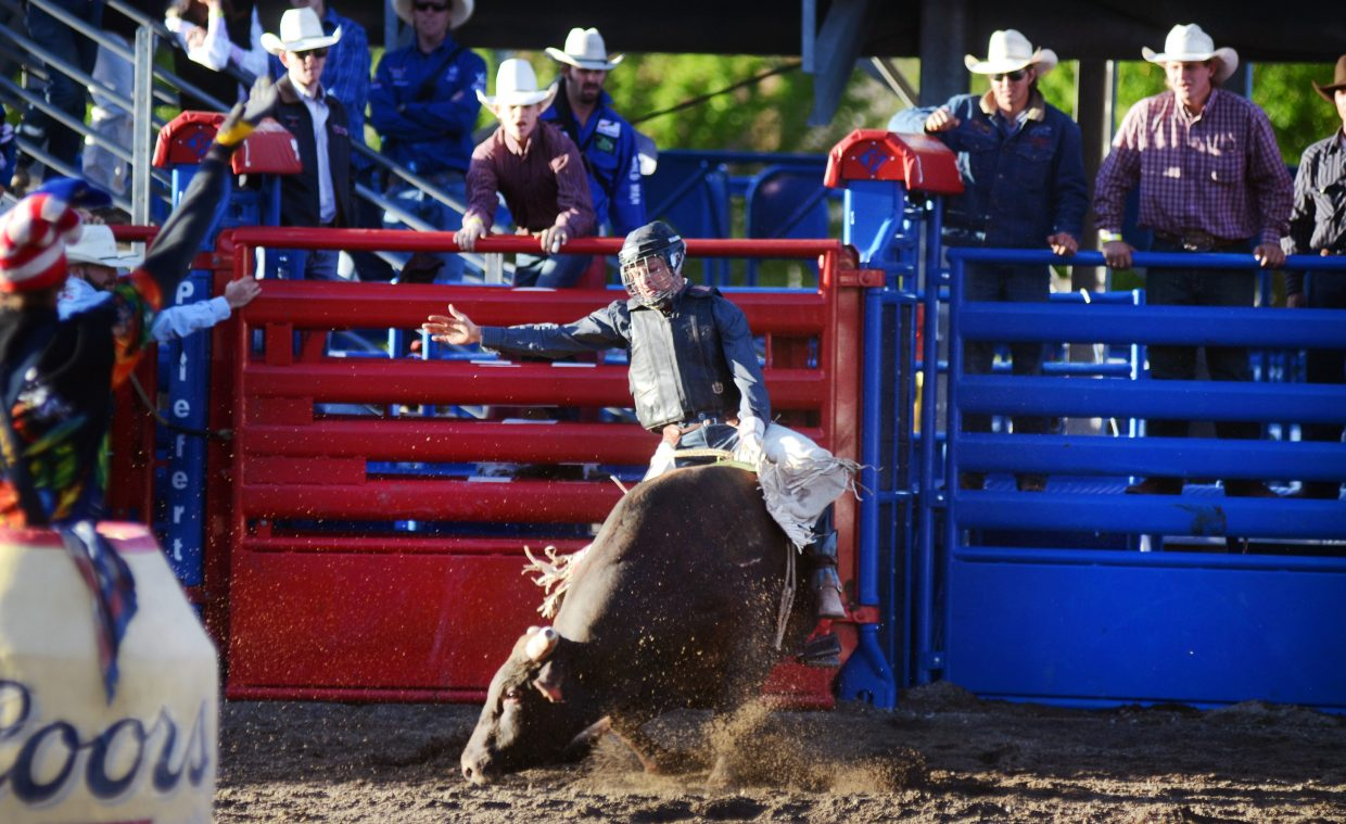 Randlett, Utah's Josh Frost flies out of the gate during the permit bull riding competition during the Saturday portion of the Steamboat Springs Pro Rodeo Series.