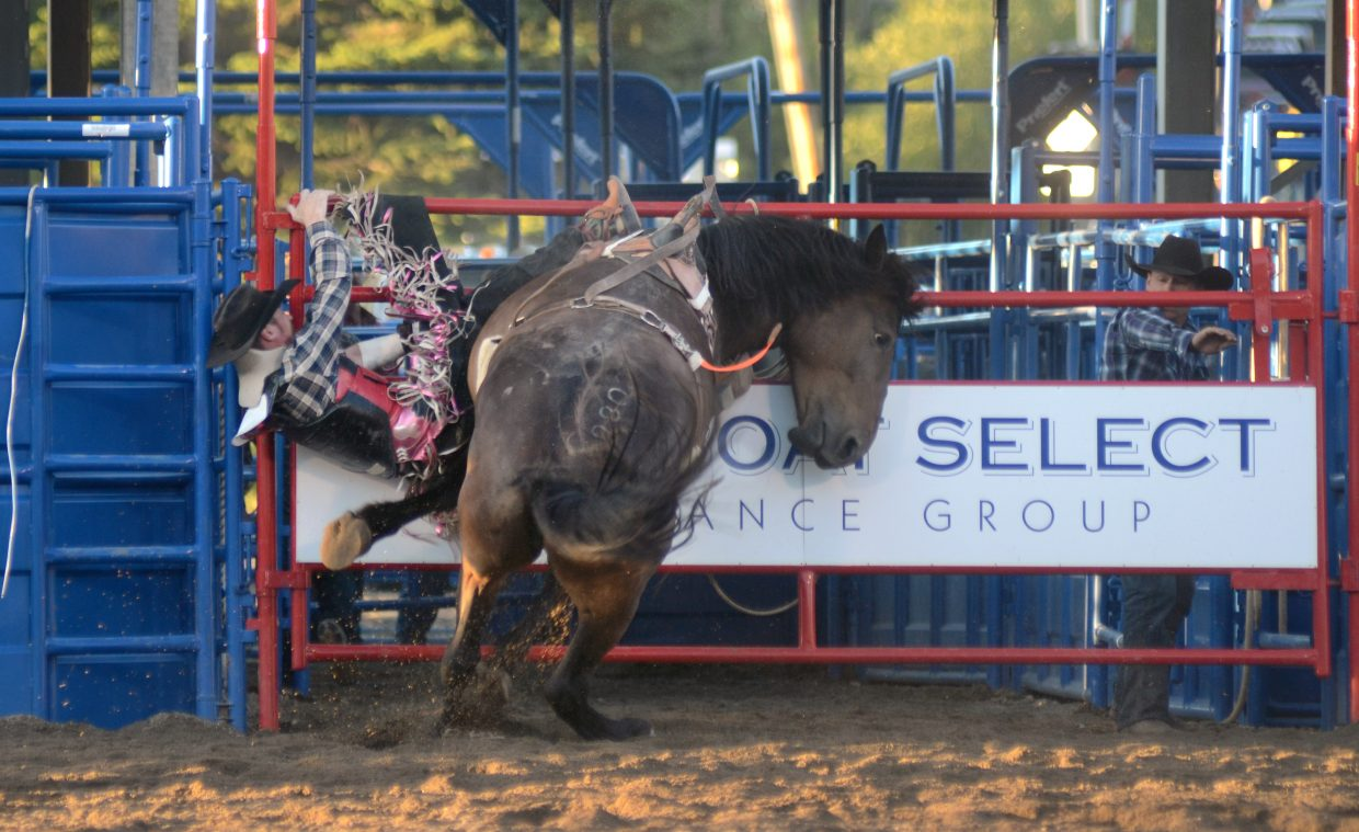 John Jackson, of Ignacio, Colo., gets a rough ending to his ride in the bareback riding competition on Saturday at the Steamboat Springs Pro Rodeo. Jackson would stay down for a moment, but get up under his own power after the slam.