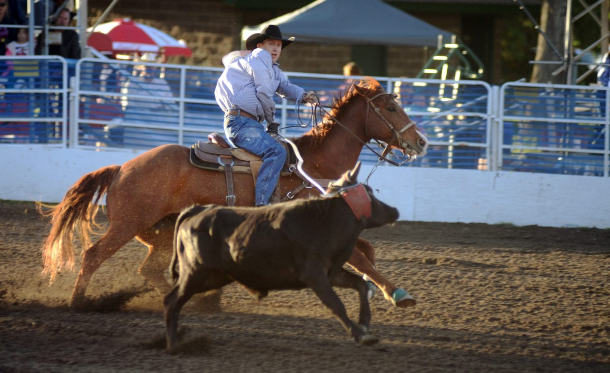 Clayton Van Aken, from California, ropes a steer in Saturday's team roping competition at the Steamboat Springs Pro Rodeo Series. Successful team roping — like most team sports — takes hours of practice to develop a pair's comfort level.