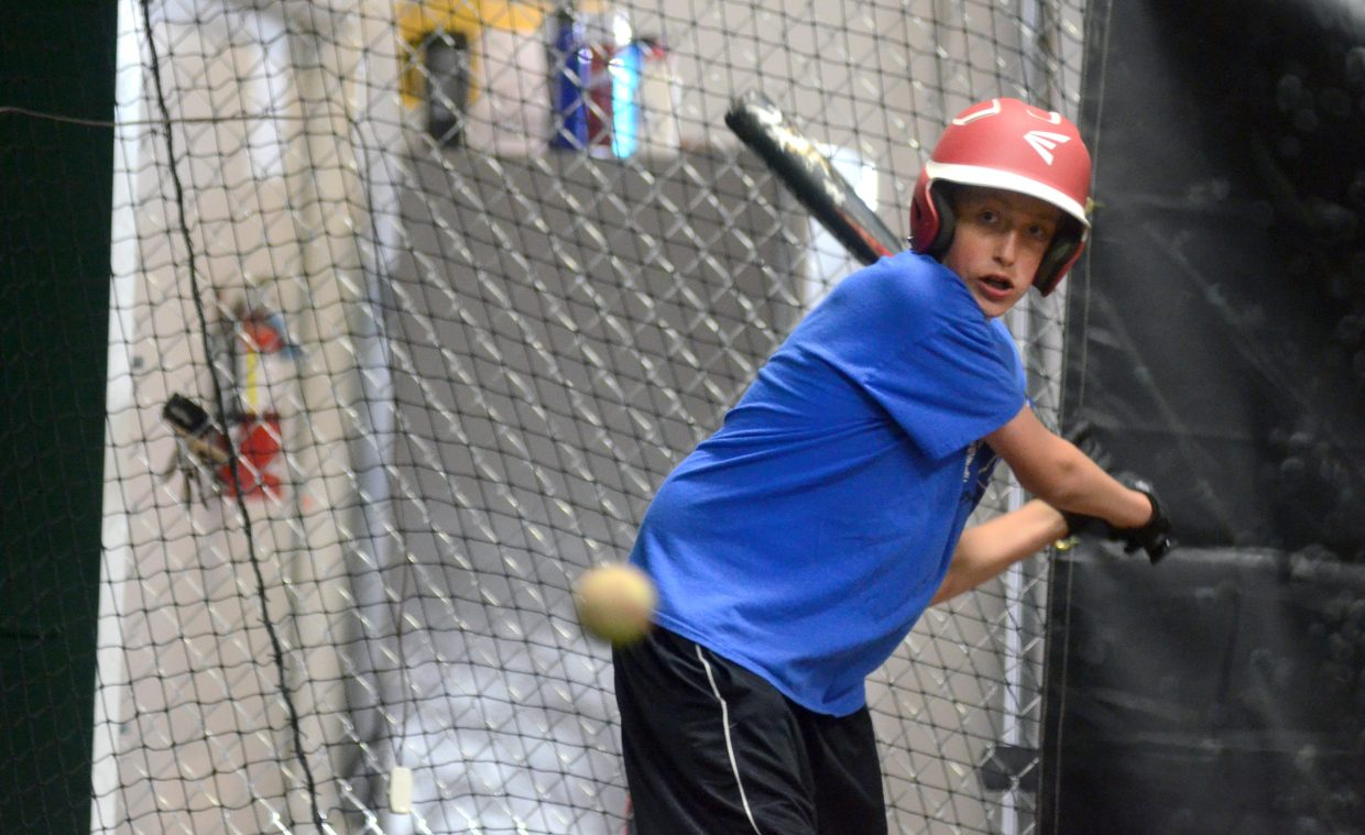 Steamboat Sailors 14s player Quintin White takes in some batting practice at the indoor hitting facility near the Steamboat Springs Airport. The annual summer Triple Crown baseball tournament begins Friday in Steamboat, Hayden, Craig and Oak Creek.