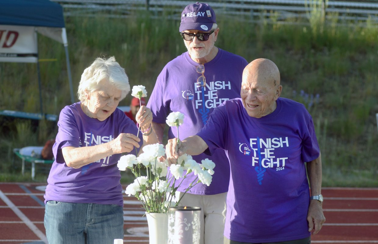 Helen Berntson, Jim Nelson and Luther Berntson wrap up the survivors lap to open the 2014 Steamboat Springs Relay For Life Friday night. The Berntsons are multiple cancer survivors, and Nelson beat prostate cancer.