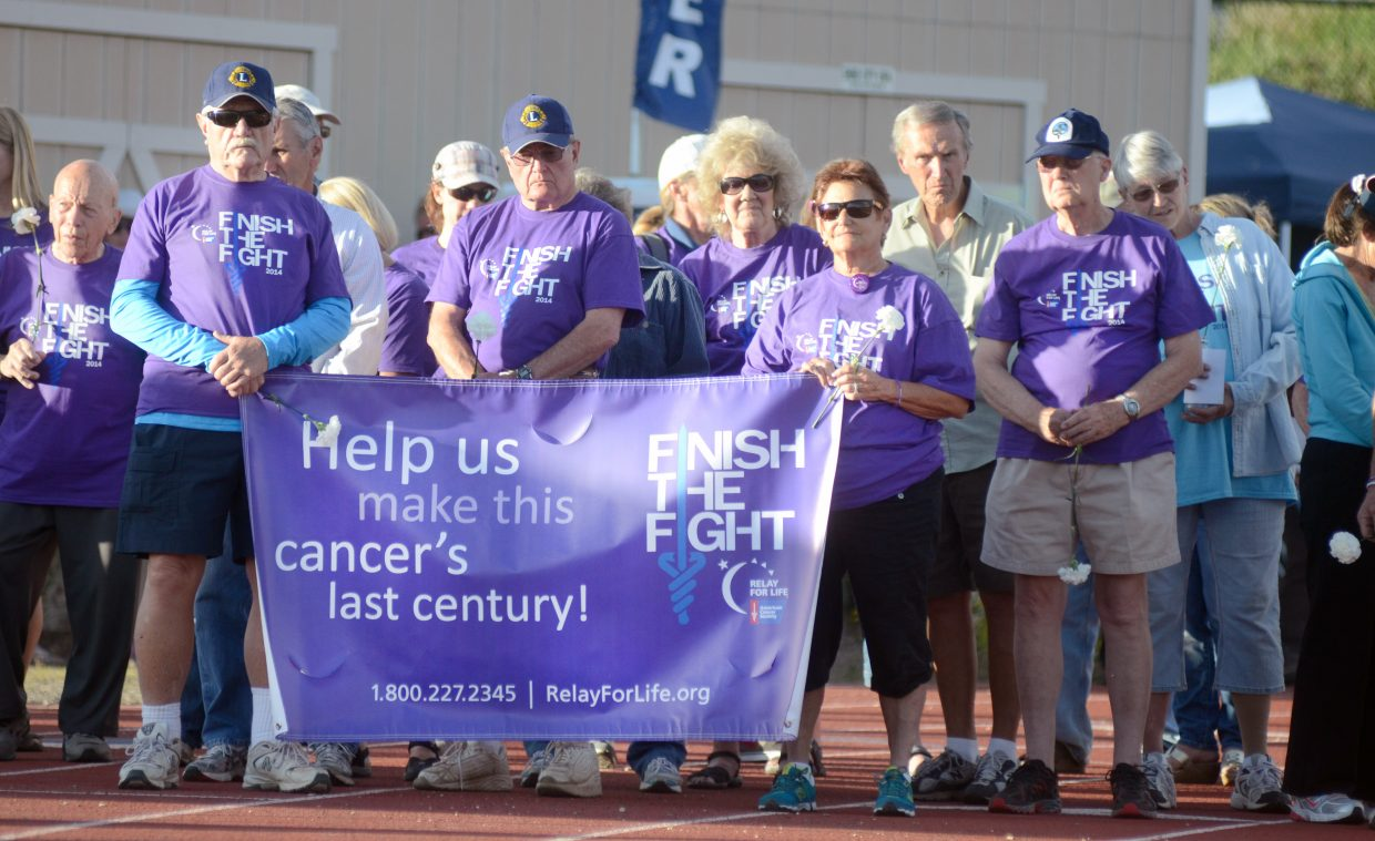 Cancer survivors start the opening lap of the 2014 Steamboat Springs Relay For Life on Friday night. More than 100 participants took part in the annual event.