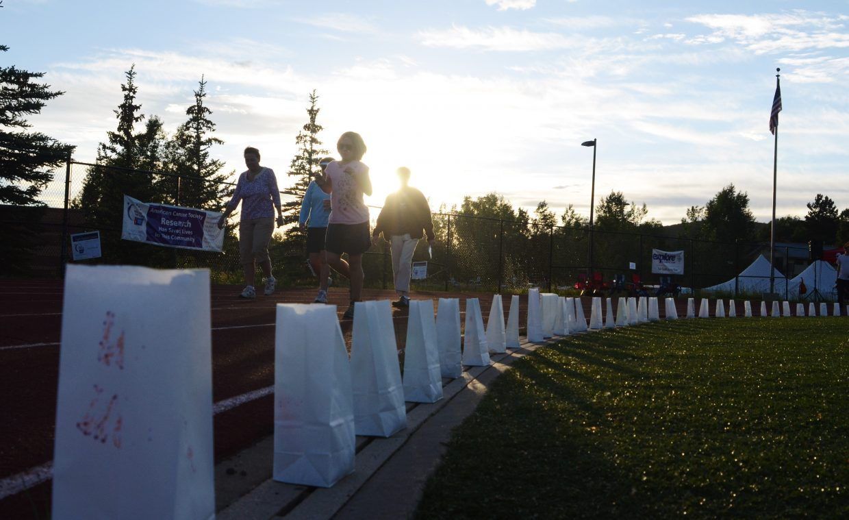 Participants round a corner at Gardner Field Friday night as the sun sets on the 2014 Steamboat Springs Relay for Life.