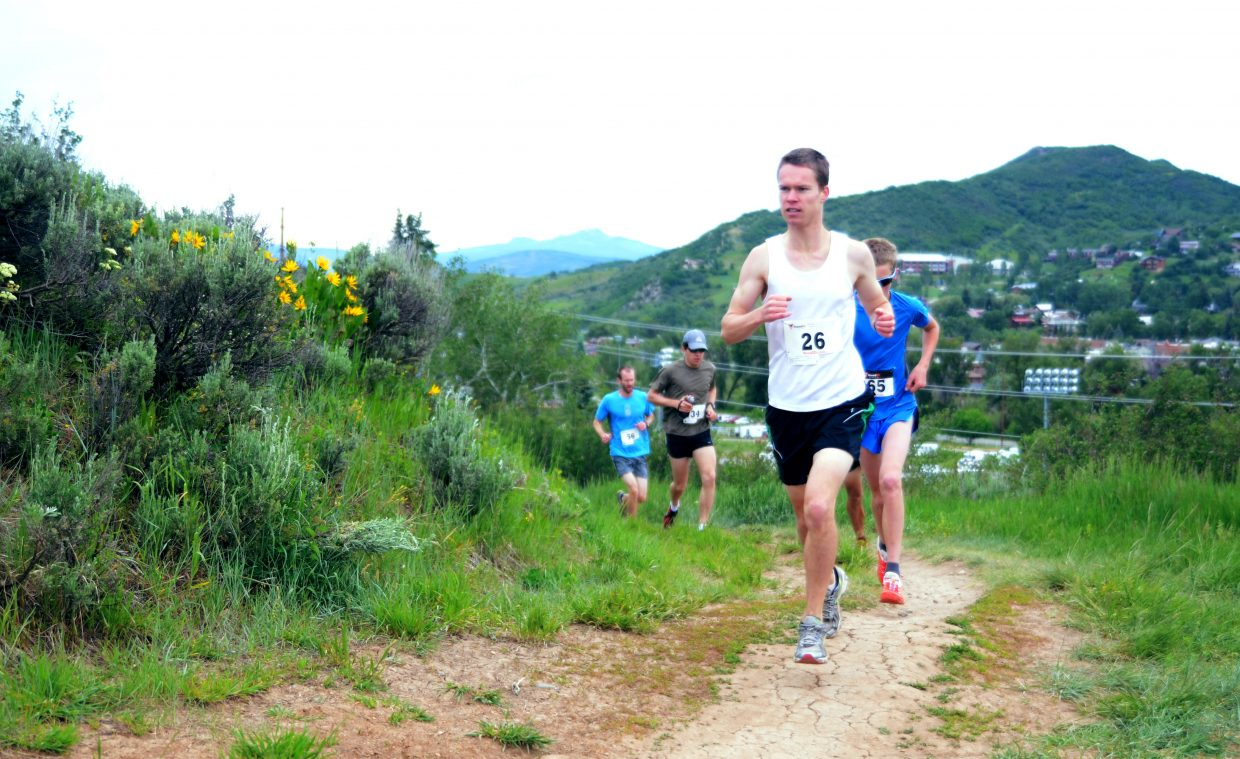 Watkins Fulk-Gray leads an early pack of runners Saturday morning during the Howelsen Hill 8-Miler Steamboat Springs Running Series race.