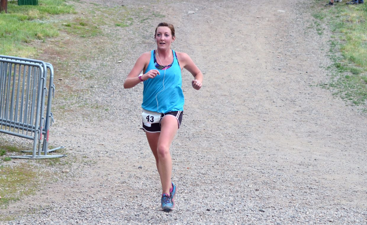 Missy Krause races to victory in the Howelsen Hill 8-Miler on Saturday morning as part of the Steamboat Springs Running Series.
