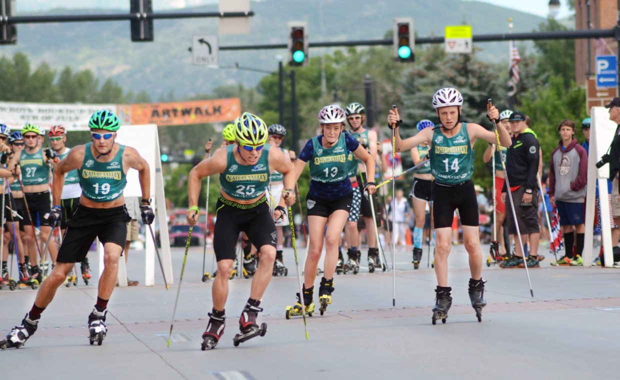 Ben Berend, No. 25, leads an early pack in Lap 1 of Friday's Nordic combined roller ski race along Lincoln Avenue as part of the annual Fourth of July festivities.