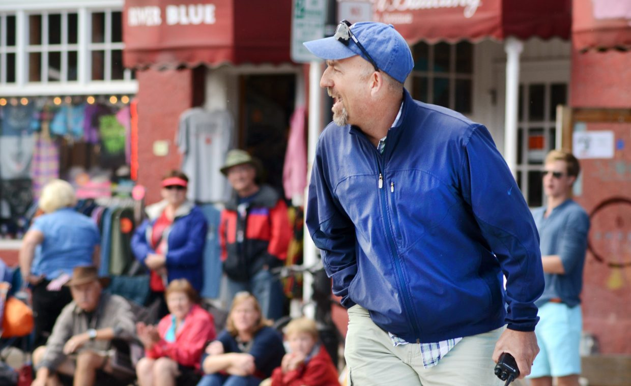 Steamboat Springs Winter Sports Club Nordic Director Todd Wilson shouts words of encouragement at racers along Lincoln Avenue in Friday's Fourth of July race.