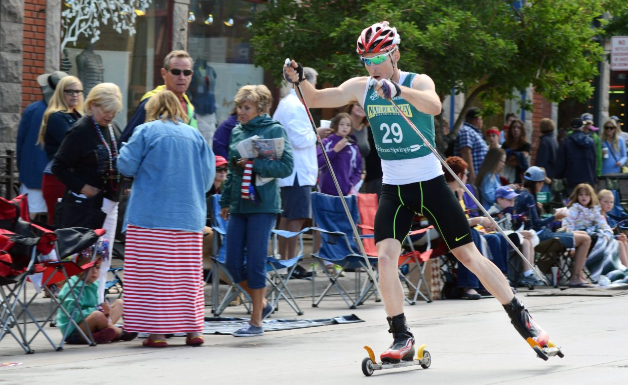 Winter Olympian Taylor Fletcher overcame a 35-second deficit Friday to win the annual Fourth of July Nordic combined competition in downtown Steamboat Springs.