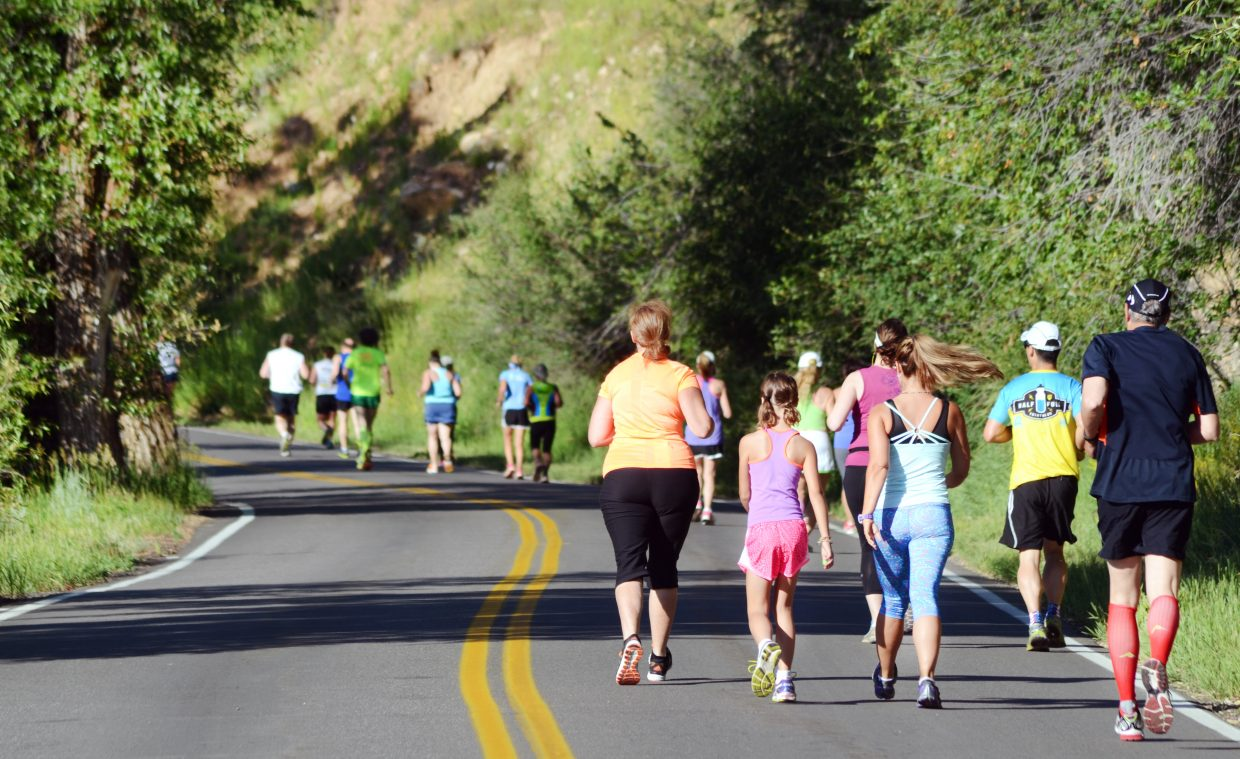 Runners in the Mountain Madness 10K and half marathon made their way up a winding River Road en route to a steep Dakota Ridge in Saturday morning's Steamboat Springs Running Series race.
