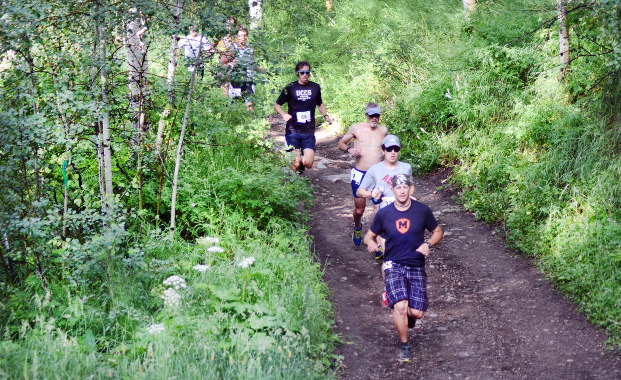 Spring Creek Memorial race 9-milers head through a shady stretch on the trail Saturday morning in the annual Steamboat Springs Running Series race.