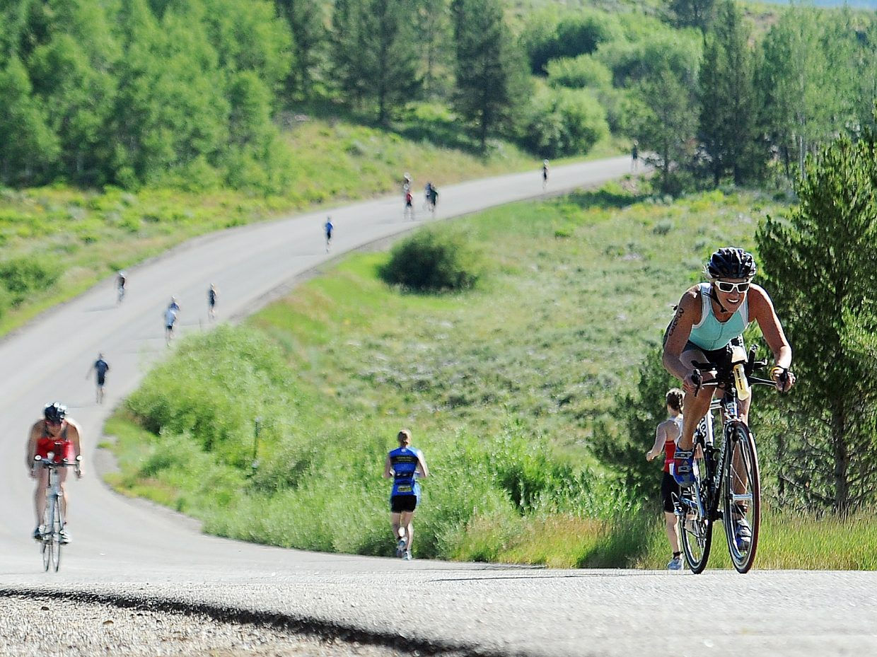 Joy Rasmussen heads up a slope on the Steamboat Lake Sprint triathlon 12.4-mile bike course during last year's race. Around 280 athletes are registered for Sunday's race as of Thursday afternoon, which would be a decline from last year's attendance. But race director Lance Panigutti is optimistic about the draw scenic North Routt County brings, especially during the warmer weeks on the Front Range.