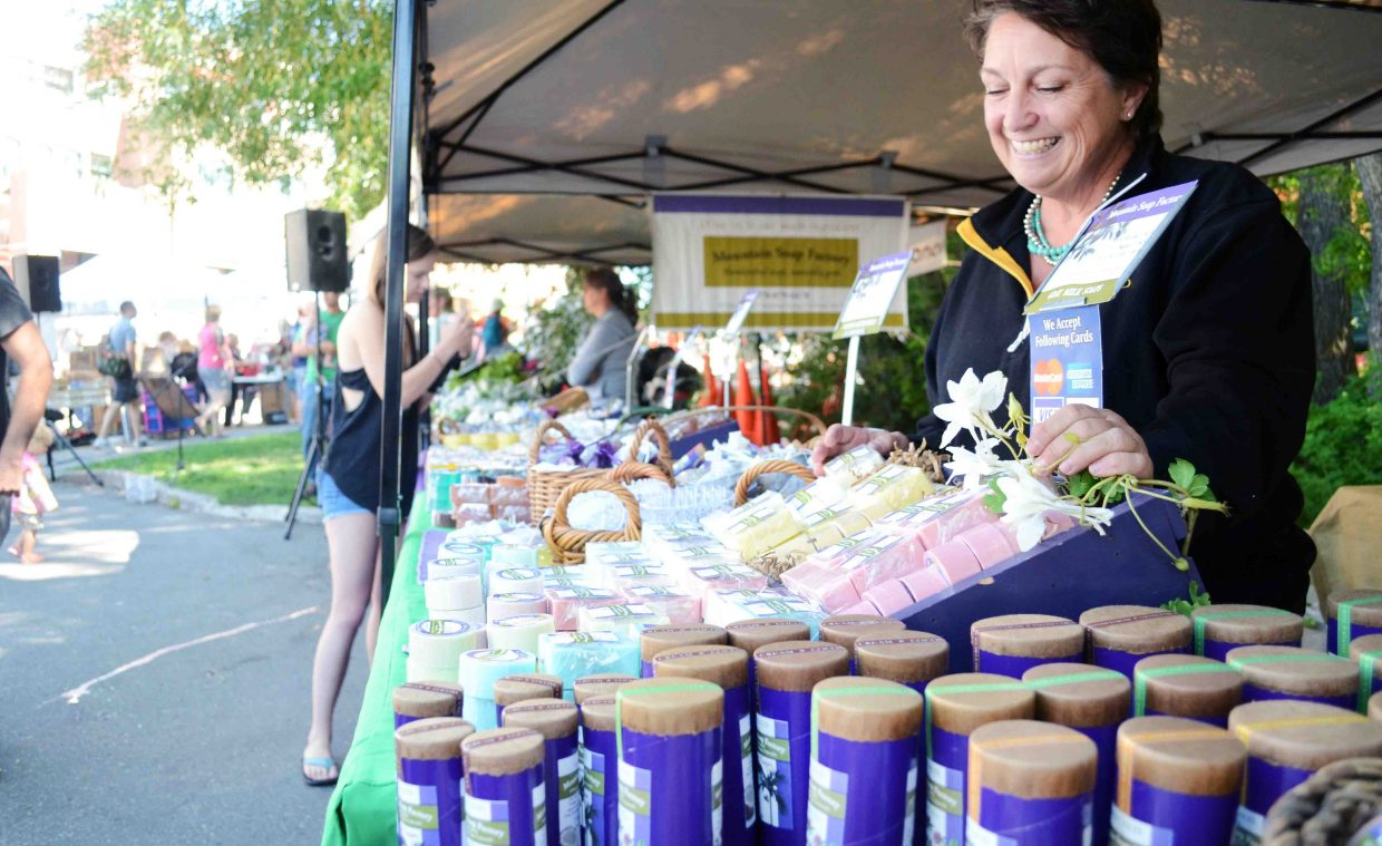 Joanne Churchill, of the Mountain Soap Factory, organizes some of the latest scents and blends at her booth this past Saturday at the Steamboat Farmers Market. This week marks National Farmers Market Week.