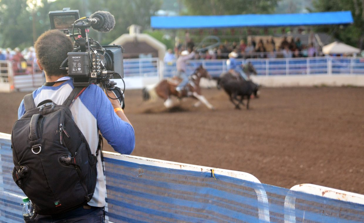 A Wahl videographer captures some footage of the team roping competition Friday at the Steamboat Springs Pro Rodeo Series. The popular hair clippers company is in town all weekend filming the rodeo and downtown for an upcoming commercial.