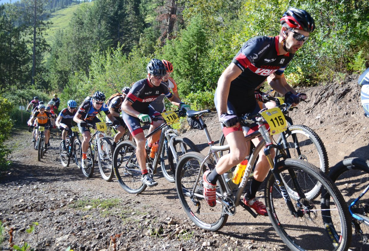 Riders head up the first steep stretch of Saturday's Steamboat Stinger mountain bike race. Hundreds of riders took to the Emerald Mountain trails for the race's fourth running.