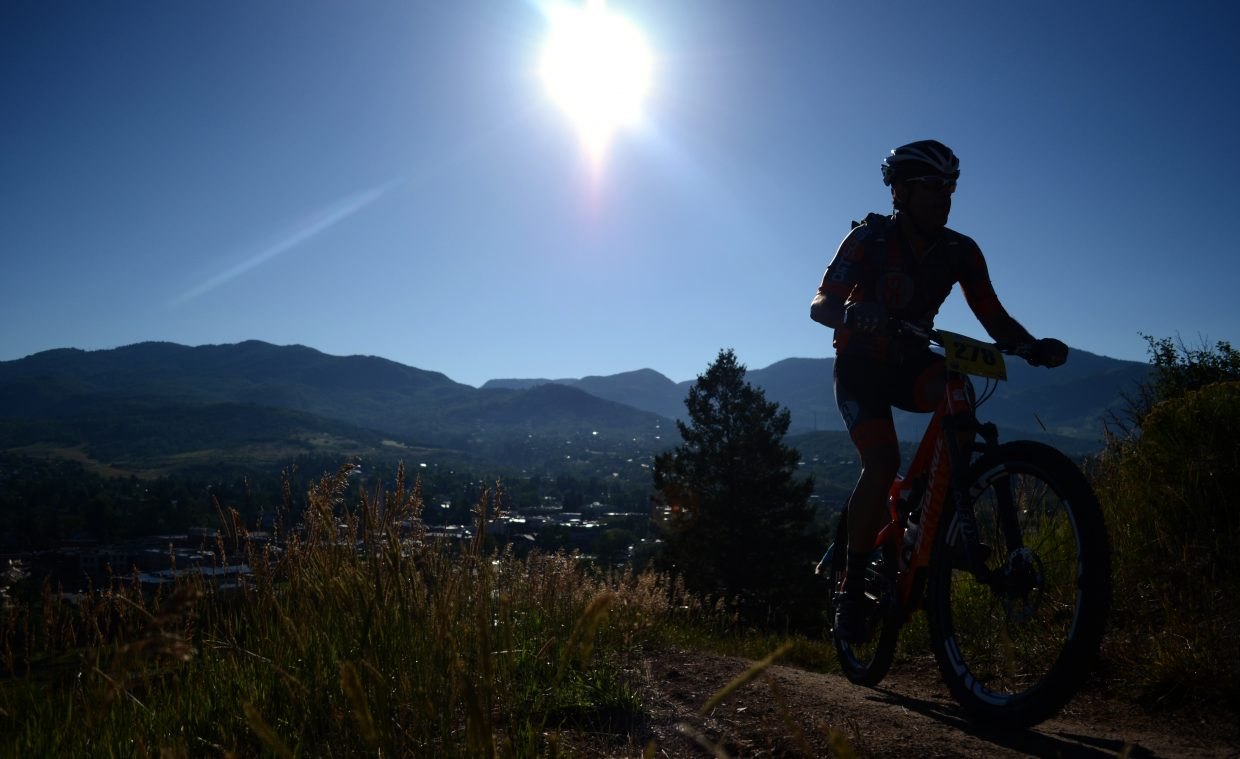 A rider races up the face of Emerald Mountain in the early stages of Saturday's Steamboat Stinger mountain bike race.